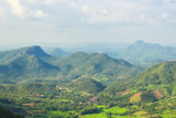 Aerial view of small village in the valley between the hills on cloudy sky - 194273017