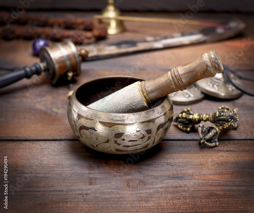 Fototapeta copper singing bowl and a wooden stick