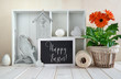 Springtime background with spring decorations. Display cabinet with Easter decorations, text