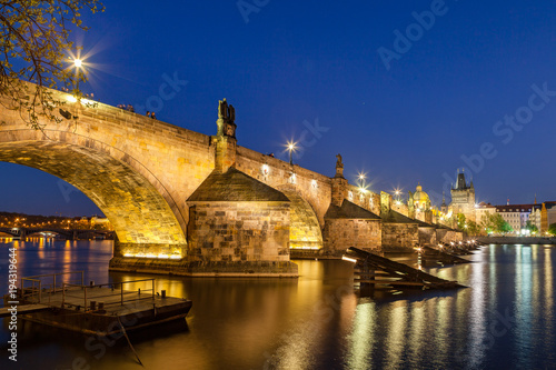 Poster Oceanië Scenic summer night view of the Charles bridge over Vltava river in Prague, Czech Republic. Illuminated beauty.