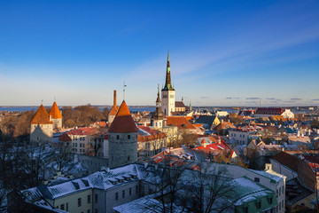 Old Tallinn architecture ensemble. Aerial view of towers, red roofs and biggest church