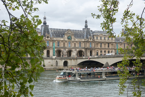 A walk on a river boat along the Tuileries Palace along the Seine River Poster