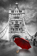 Tower Bridge on River Thames with umbrella on a raining day. London, England. Black and white concept graphic with red element. - 194344865