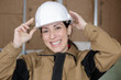 female worker with hard hat smiling