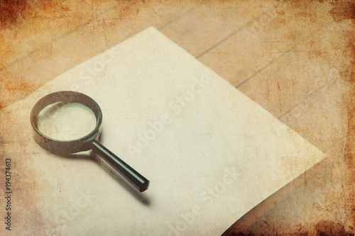 Magnifier and book