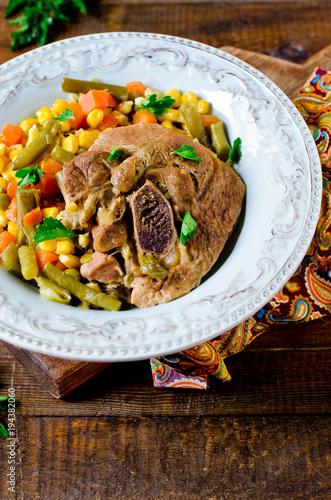 Thigh of turkey stew with vegetables: corn, green beans, carrots and bell pepper © teleginatania