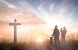 Family worship concept: Silhouette people looking for the cross on autumn sunrise background. - 194408054