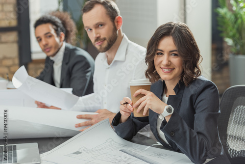 team of happy architects working together at modern office