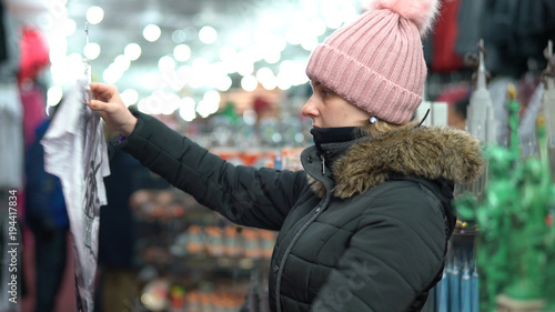 Attractive young woman shopping at gift shop