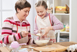 Mother and daughter cooking and having fun, home kitchen interior, healthy food concept - 194421042