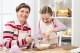Mother and daughter cooking and having fun, home kitchen interior, healthy food concept - 194421077