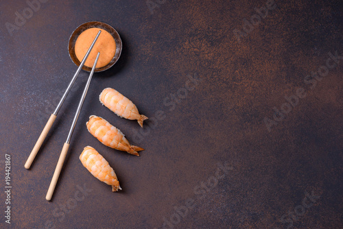 Fotobehang Sushi bar Sushi nigiri with shrimp and sauce with copy space