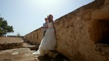 Beautiful bride and groom posing on the background of ancient ruins in greece. - 194429642