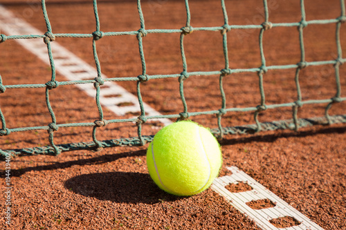 Fotobehang Tennis tennis ball with line and net on a sand court