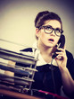 Business woman in office talking on phone