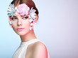 Face of Beautiful Woman Decorated with Flowers. Perfect Makeup. Beauty Fashion Model Woman Face perfect Skin. Paper Flowers