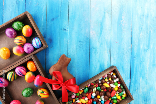 Chocolate Easter eggs and chocolate bunny and colorful sweets.