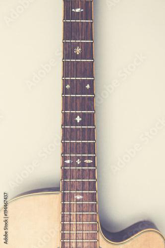 Wooden acoustic guitar against a plain background - 194467437