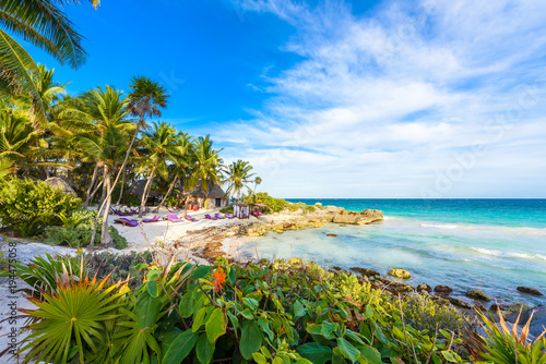 Fototapeta Recreation at paradise beach resort with turquoise waters of Caribbean Sea at Tulum, close to Cancun, Riviera Maya, tropical destination for vacation, Mexico