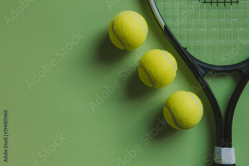 Aluminium Tennis Three tennis balls and a tennis racket on green background, with copy space.