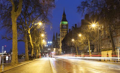 Poster night scene of Big Ben and London city street with car trails of light. United Kingdom