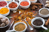 Herbs and spices in ceramic bowls. - 194504463