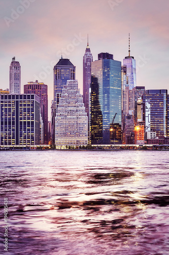 New York Manhattan skyline at sunset, color toned picture, New York City, USA.