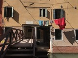 Venice, a typical building and a wooden bridge - 194506013