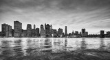 Black and white panoramic picture of the Manhattan skyline at dusk, New York City, USA.