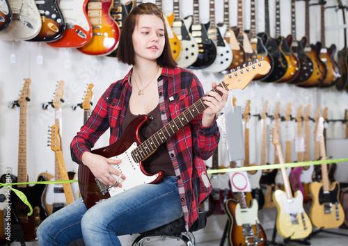 Teenage customer deciding on suitable amp