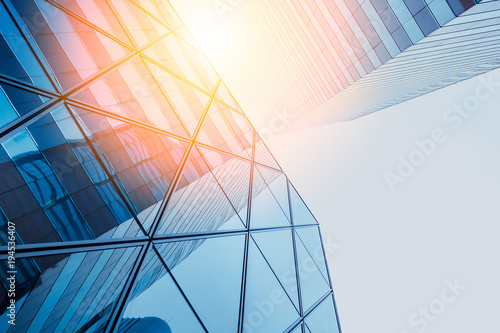Reflections of modern commercial buildings on glasses with sunlight - 194536407