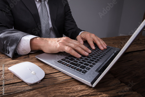 Businessman's Hand Using Laptop