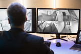 Businessman Looking At CCTV Camera Footage