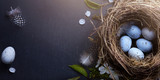 Happy Easter;  Easter eggs in nest and spring flower on table background - 194551402
