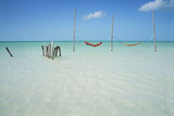 Hammocks hanging over crystal clear water, paradisiacal Caribe - 194552669