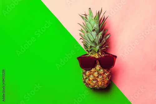 pineapple on colored paper with glasses - 194553218
