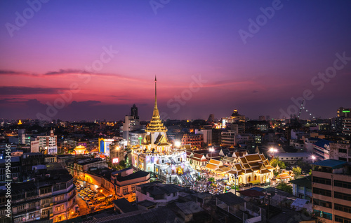 Top view cityscape Wat Trimit  in chinatown or yaowarat area at twilight time  Bangkok  Thailand.