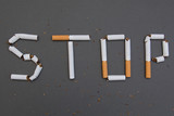 Stop smoking. Cigarettes cause cancer and kill. Gray background. - 194563211