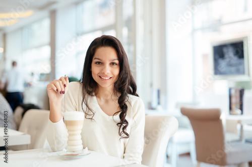 Glamorous lady drinking coffee