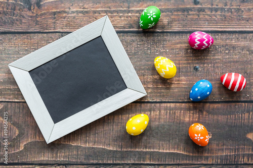 Wooden table with easter eggs - 194564275