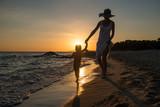 Joy of life on beach at dusk, mom and kid