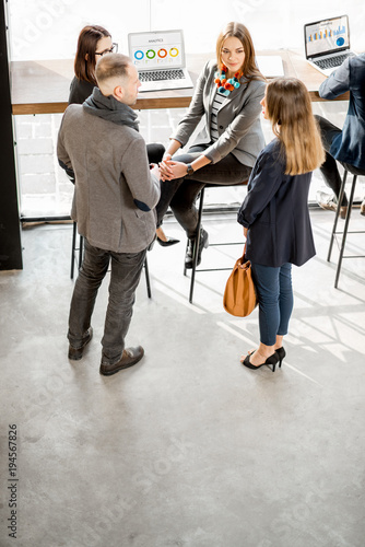 Business people having a conversation during the coffee break in the cafe