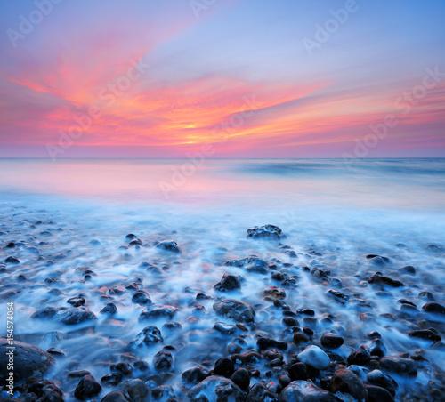 Aluminium Zee zonsondergang Sunset by the Sea, Waves rolling in, long exposure, Atlantic Ocean, Normandy, France