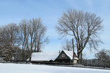 old beautiful wooden cottage and some bare trees in winter on Grun, Beskydy mountains, Czech Republic, February 17, 2018 - 194575013