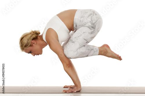 Aluminium School de yoga Yoga, sport, training and lifestyle concept - Young blonde woman in white sportswear doing yoga practice.Crane pose ,bakasana