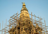 Pigeons on some scaffolding around Krishna temple on Patan Durbar Square, in Patan, Nepal. The temple was damaged by the April 2015 Nepal earthquake. - 194579426