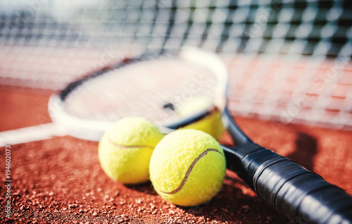 Tennis ball with racket on the tennis court. Sport, recreation concept