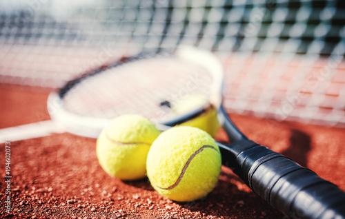 Aluminium Tennis Tennis ball with racket on the tennis court. Sport, recreation concept