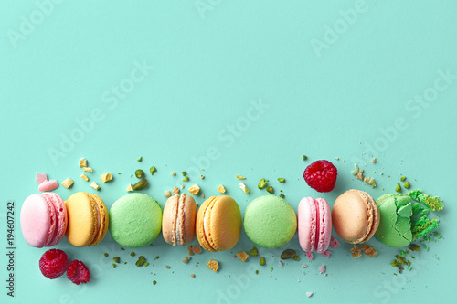 Colorful french macarons on blue background Poster