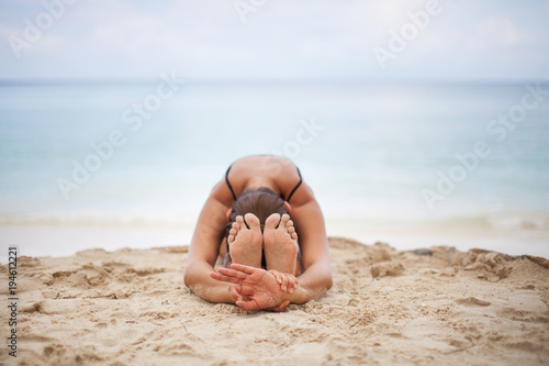 Plakat Woman In Relaxation On Tropical Beach with sand , body parts .yoga, and meditation
